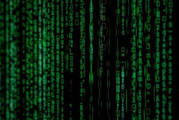 Green matrix code on a black screen